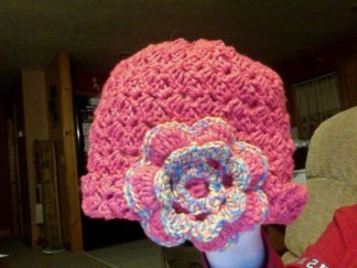 Pink girls hat with flower also made one in blue