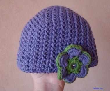 Purple newborn hat with flower $15