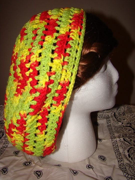 Side view of red, yellow, green baggie beret