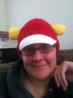 Corny Hat:  Red Beanie with White bill and corn cob sticking thru it