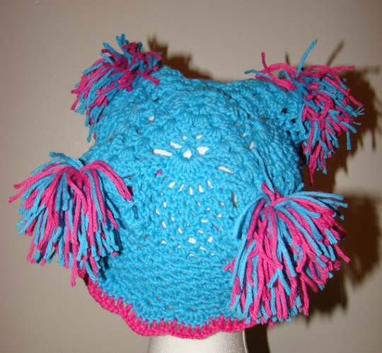 back view of blue and pink children's cotton pom pom hat