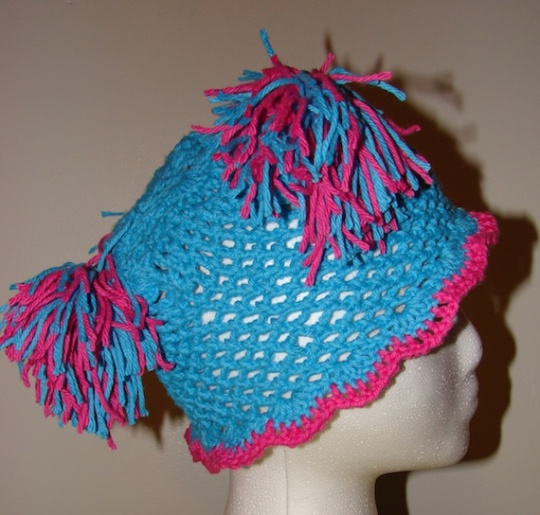 side view of blue and pink children's cotton pom pom hat