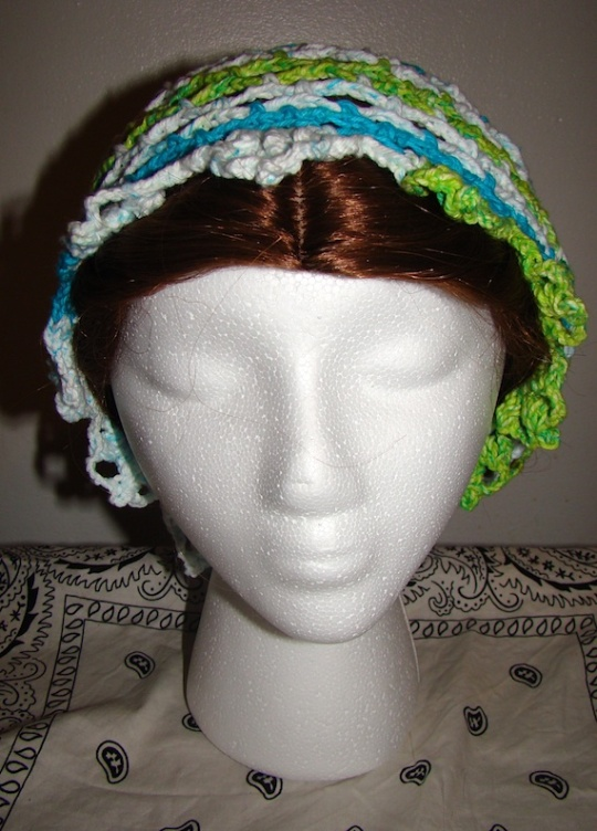 Front of blue, green, white baggie star hat