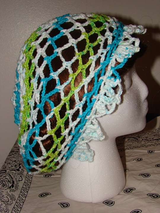 side view of blue, green, white baggie star hat