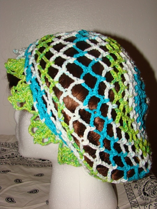 Other Side view of blue, green, white baggie star hat
