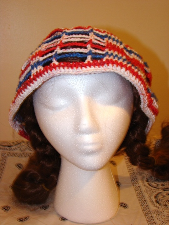 front of red, white and blue USA sun hat