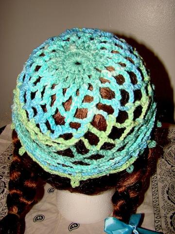 Back of blue/green Web Hat