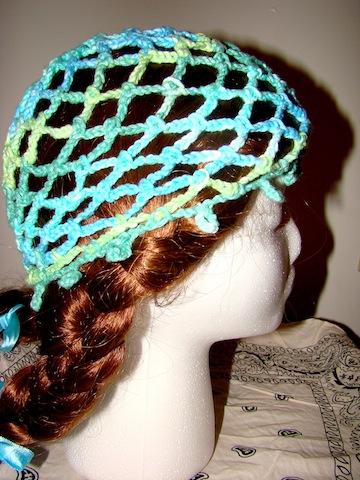 Side of blue/green Web Hat