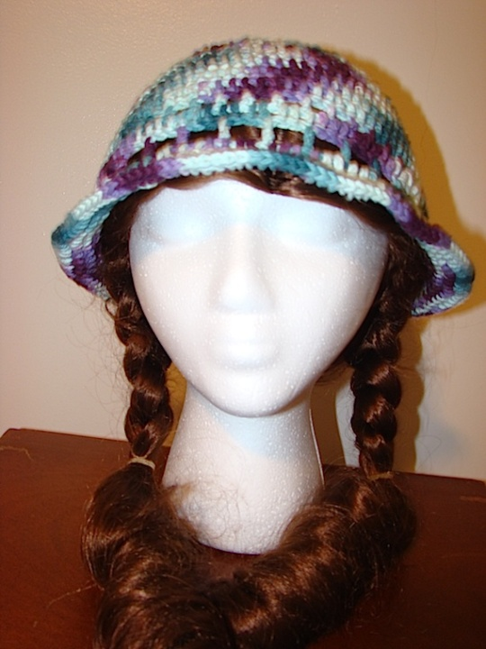 front view of green and purple multi-colored sun hat