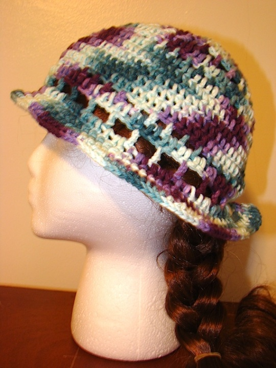 side view of purple green multi-colored sun hat
