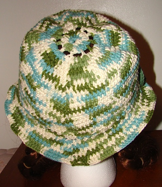 back view of green and white multi colored sun hat