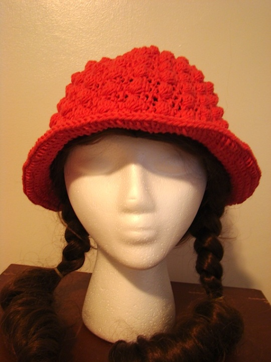front view of pink bobble sun hat