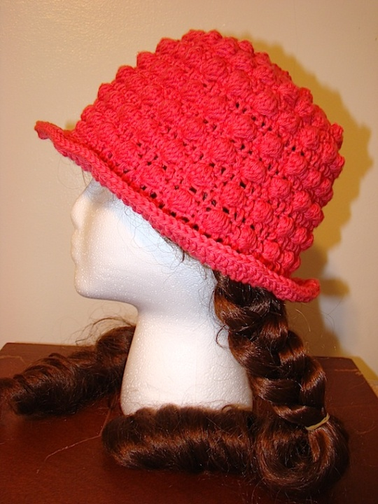 side view of pink bobble sun hat