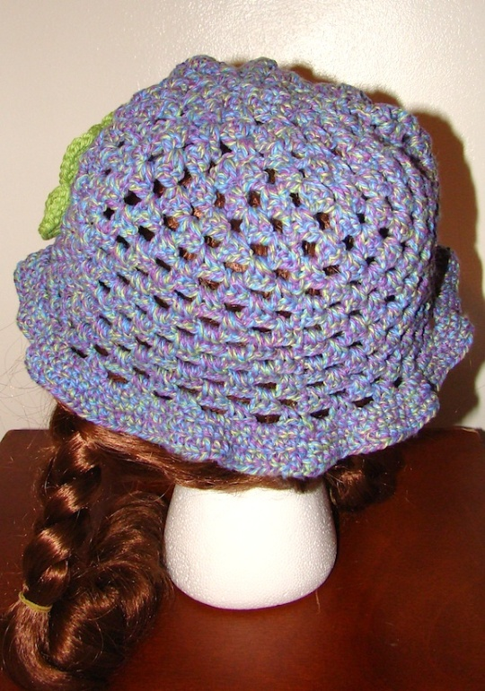 back view of purple with green flower sun hat