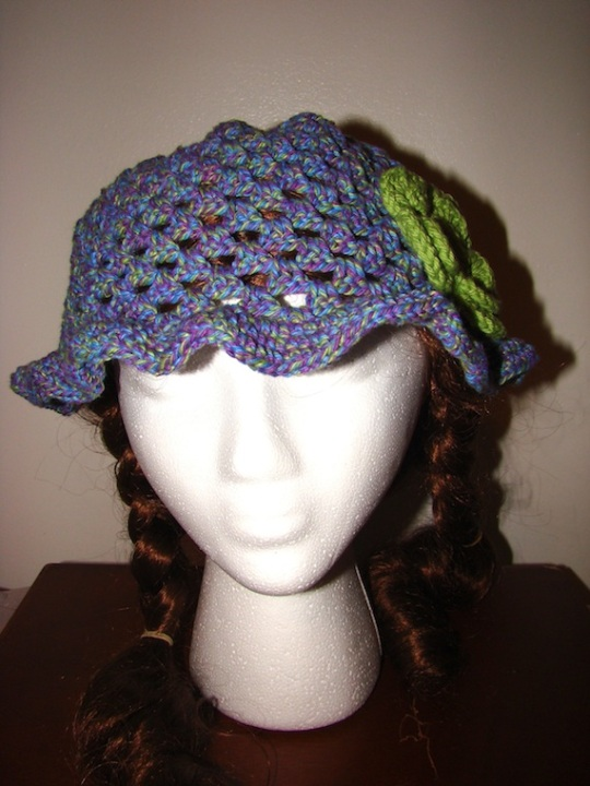 front view of purple with green flower sun hat