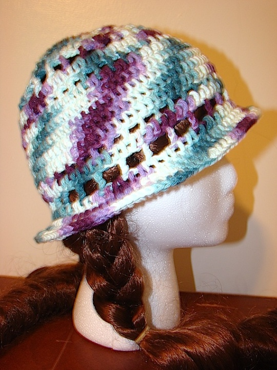 other side view of purple green multi-colored sun hat