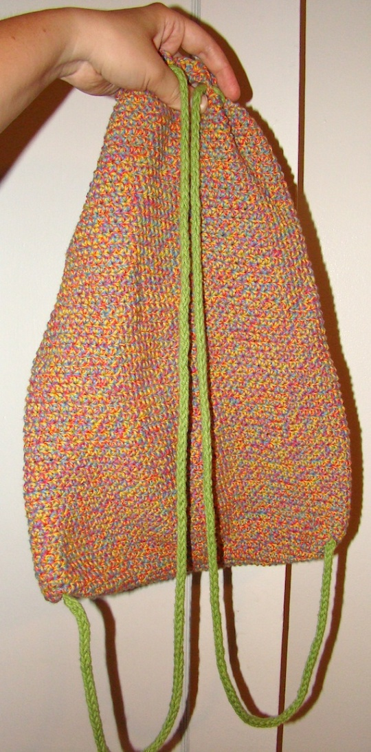 back view of rainbow bag with green straps