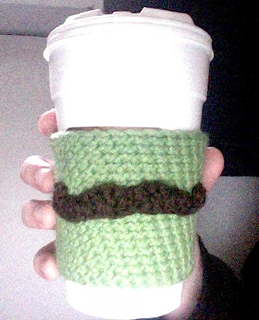 mustache coffee coozie.  green coozie with brown mustache