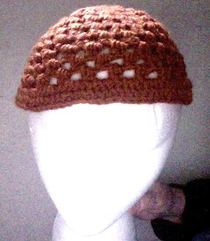 front view of orange open stitch meditation hat