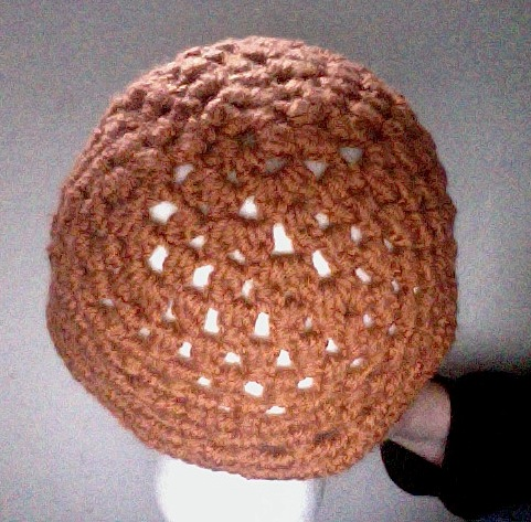 back view of orange meditation hat