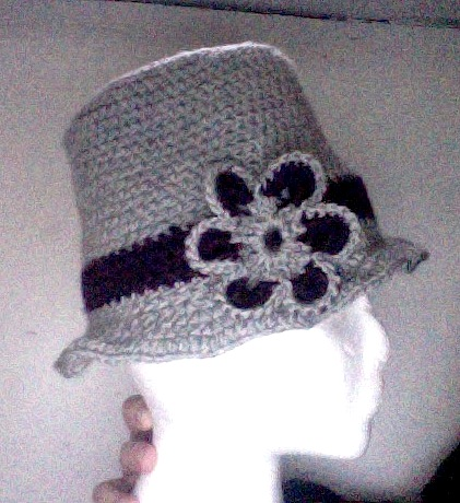 side of gray and purple flower hat when worn above the ears
