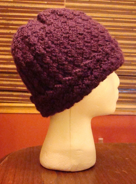 Side view of purple crochet winter hat