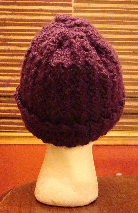 Back view of a purple crochet winter hat
